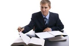 Hombre de negocios joven en el trabajo Imagen de archivo libre de regalías