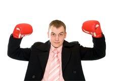 Hombre de negocios joven en guante de boxeo Fotografía de archivo