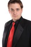 Hombre de negocios joven en juego formal negro Fotos de archivo
