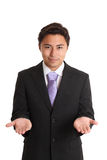 Hombre de negocios joven en un traje y un lazo Foto de archivo libre de regalías