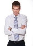 Hombre de negocios joven enojado aislado en blanco. Imagen de archivo libre de regalías