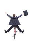 Hombre de negocios joven feliz en una bicicleta Imagenes de archivo