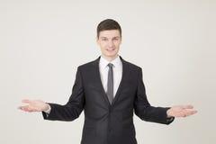 Hombre de negocios joven hermoso con las palmas abiertas Imágenes de archivo libres de regalías