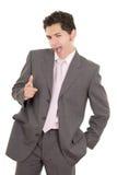 Hombre de negocios joven hispánico feliz con los pulgares para arriba Foto de archivo