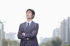 Hombre de negocios joven Looking Away Imagenes de archivo