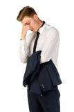 Hombre de negocios joven pensativo aislado en blanco Foto de archivo