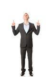 Hombre de negocios joven Pointing Upwards Foto de archivo libre de regalías