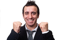 Hombre de negocios joven que disfruta del éxito aislado en blanco Imagenes de archivo