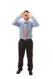 Hombre de negocios joven que grita hacia fuera en alta voz Imagen de archivo