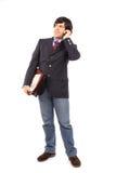 Hombre de negocios joven que habla en el teléfono celular Fotos de archivo libres de regalías
