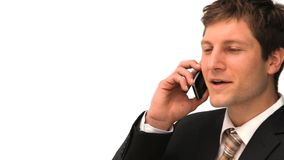 Hombre de negocios joven que hace una llamada de teléfono almacen de video