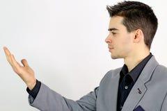 Hombre de negocios joven que mira su mano Imágenes de archivo libres de regalías