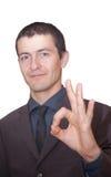 Hombre de negocios joven que muestra muy bien Imagenes de archivo