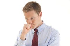 Hombre de negocios joven que piensa con la mano en la barbilla imagen de archivo libre de regalías