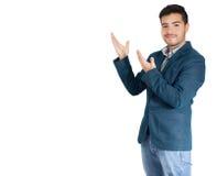 Hombre de negocios joven que presenta algo Fotografía de archivo libre de regalías