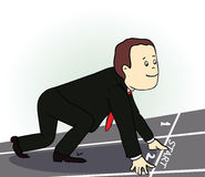 Hombre de negocios joven que se coloca en la posición de comienzo Foto de archivo libre de regalías