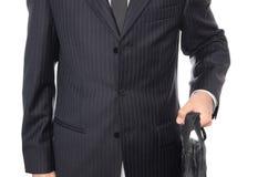 Hombre de negocios joven que sostiene la maleta Fotografía de archivo libre de regalías