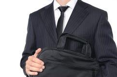 Hombre de negocios joven que sostiene la maleta Imagen de archivo