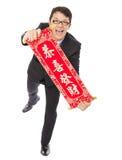 Hombre de negocios joven que sostiene un carrete de la enhorabuena imagenes de archivo