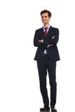Hombre de negocios joven sonriente en el traje y el lazo, soñando Imagenes de archivo