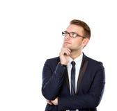 Hombre de negocios joven Thinking, aislado Imagen de archivo