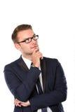 Hombre de negocios joven Thinking, aislado Fotografía de archivo