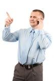 Hombre de negocios joven usando el teléfono móvil Fotografía de archivo libre de regalías