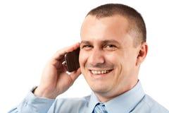 Hombre de negocios joven usando el teléfono móvil Foto de archivo libre de regalías