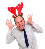 Hombre de negocios loco con traje del reno de Rudolph. Imágenes de archivo libres de regalías