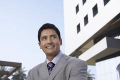 Hombre de negocios Looking Away In Front Of Office Building Fotografía de archivo