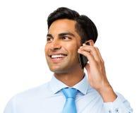 Hombre de negocios Looking Away While que contesta al teléfono elegante Imagen de archivo