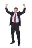 Hombre de negocios maduro emocionado Fotos de archivo