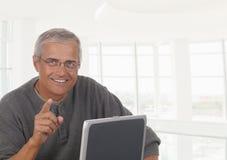 Hombre de negocios maduro Laptop Office Imagen de archivo