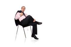 Hombre de negocios maduro que se relaja Imagen de archivo libre de regalías
