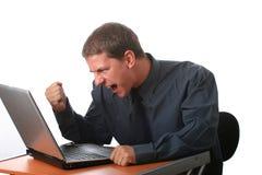 Hombre de negocios masculino con la computadora portátil Fotografía de archivo