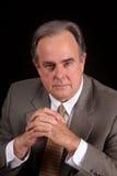 Hombre de negocios masculino maduro con una expresión seria Fotos de archivo libres de regalías
