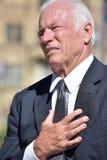 Hombre de negocios mayor adulto afligido Wearing Business Suit imagen de archivo libre de regalías
