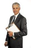 Hombre de negocios mayor con el sujetapapeles foto de archivo libre de regalías
