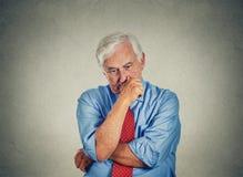 Hombre de negocios mayor preocupante triste del primer Foto de archivo libre de regalías