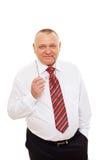 Hombre de negocios mayor sonriente con los vidrios Imagen de archivo libre de regalías