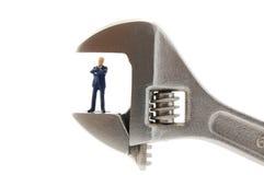 Hombre de negocios minúsculo en la tensión Fotos de archivo libres de regalías