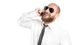 Hombre de negocios moderno feliz en el teléfono Imagen de archivo