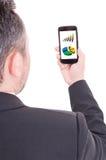 Hombre de negocios moderno que comprueba estadísticas financieras Foto de archivo libre de regalías