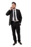Hombre de negocios moderno que contesta en su iphone Fotografía de archivo