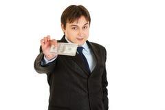Hombre de negocios moderno sonriente que lleva a cabo cientos dólares Imágenes de archivo libres de regalías