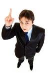 Hombre de negocios moderno sorprendido con el dedo rised Imagen de archivo libre de regalías