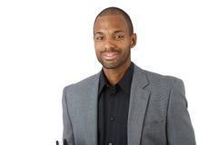 Hombre de negocios negro confiado feliz Foto de archivo