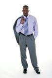 Hombre de negocios ocasional en juego gris foto de archivo