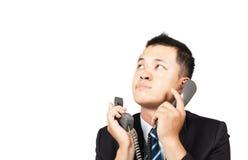 Hombre de negocios ocupado en el teléfono Imagen de archivo libre de regalías