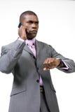 Hombre de negocios ocupado en el teléfono Foto de archivo libre de regalías
